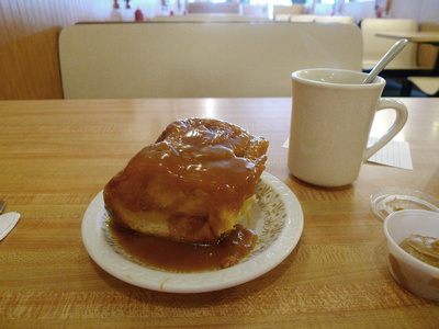 Caramel roll and coffee at Charlie's Cafe